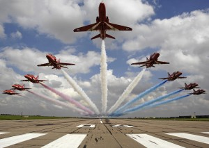 Pictured are The Red Arrows performing a low level flypast over 04 threshold at RAF Scampton. The Royal Air Force Aerobatic Team, the Red Arrows, is one of the world's premier aerobatic display teams. Representing the speed, agility and precision of the RAF, the team is the public face of the service. They assist in recruiting to the Armed Forces, act as ambassadors for the United Kingdom and promote the best of British. Flying distinctive Hawk jets, the team is made up of pilots, engineers and essential support staff with frontline, operational experience.